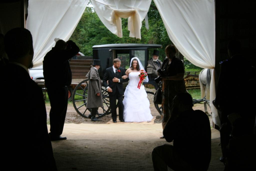 Jennifer alights from her horse-drawn coach for her barn wedding at Allegra Farm.