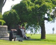 Bride, groom, and photographer on the steps of the Branford Mansion at Avery Point