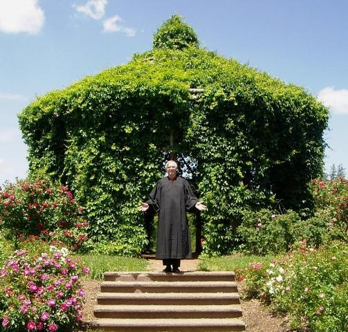 The Elizabeth Park Rose Garden gazebo with your wedding officiant in a judicial robe.