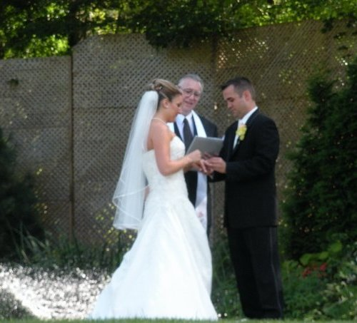 Lorrien and Kevin exchanging ring vows at Woodwinds in Branford, CT