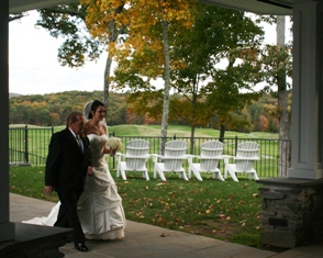 A beautifil bride escorted at her October wedding at Fox Hopyard