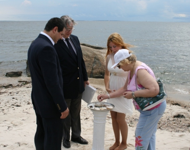 A shell ceremony during a seaside wedding in Harkness Park, CT.