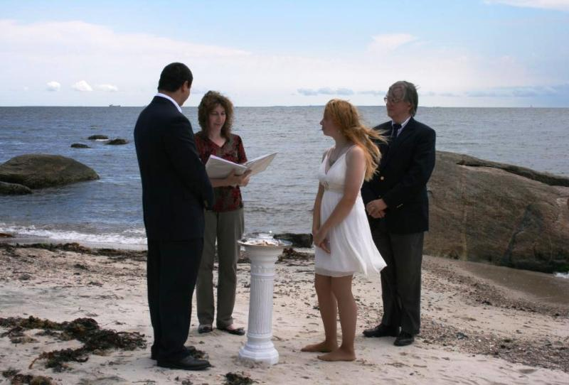 Lyndsay's mother reads from Kahlil Gibran at her daughter's beach wedding in Harkness Memorial State Park in Waterford, CT