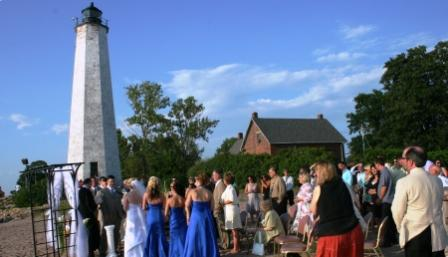 Wedding ceremony by the lighthouse at Lighthouse Point, CT