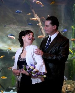 Colorful fish make an impressive wedding background at Mystic Aquarium.