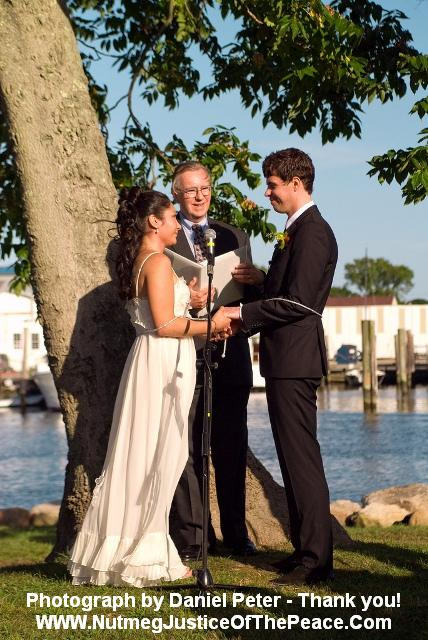 Sunset wedding at Mystic Arts Center by the Mystic River in Mystic, CT.  Photo by Daniel Peter.