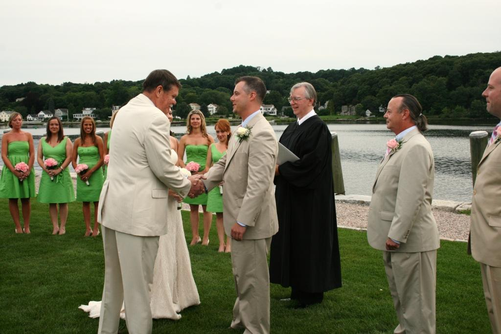 Denise's father congratulates Patrick at the Mystic Seaport North Lawn wedding.