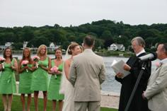 Bride, groom, and guests enjoy hearing anecdotes from Denise and Patrick's past at their riverside wedding in Mystic, CT.