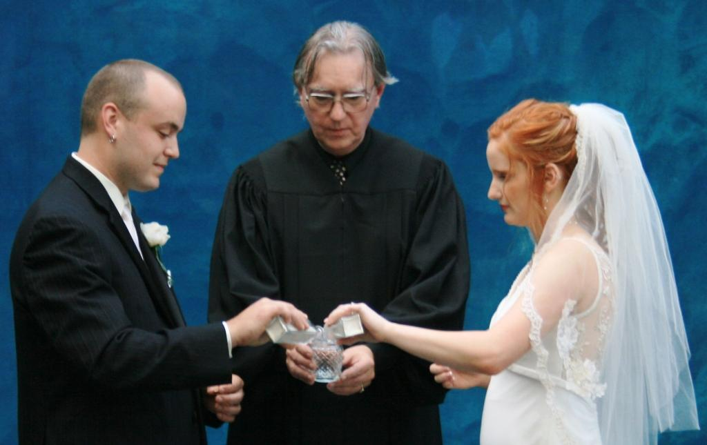 Elizabeth and James chose a sand ceremony to signify the joining of their lives at Mystic Aquarium.