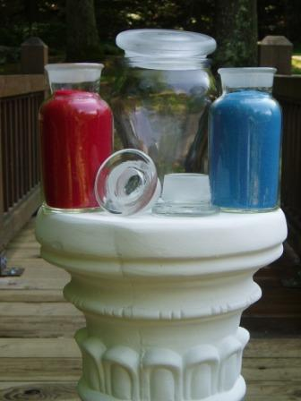 Red and blue sand in glass bottles ready for a Sand Ceremony
