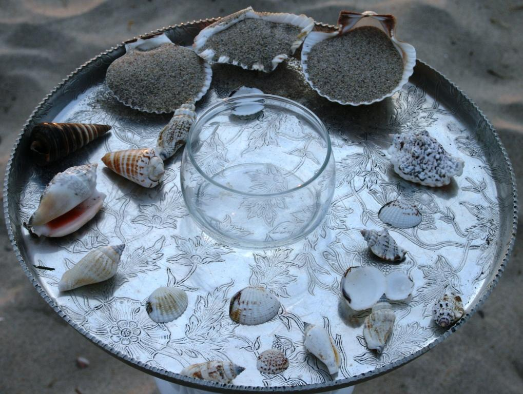 Beach sand and seashells for a beach wedding at sunset