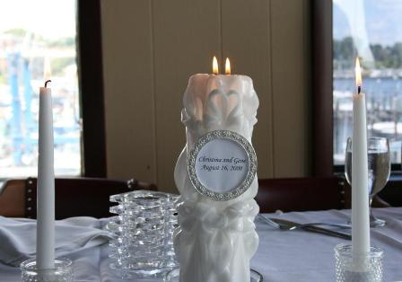 Christina and Gene's unity candle and tapers on their head table
